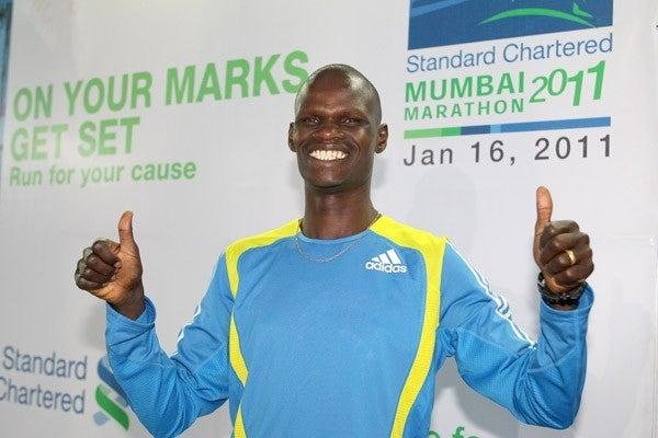 John Kelai gives a thumbs up to the press in Mumbai. Photo: IAAF