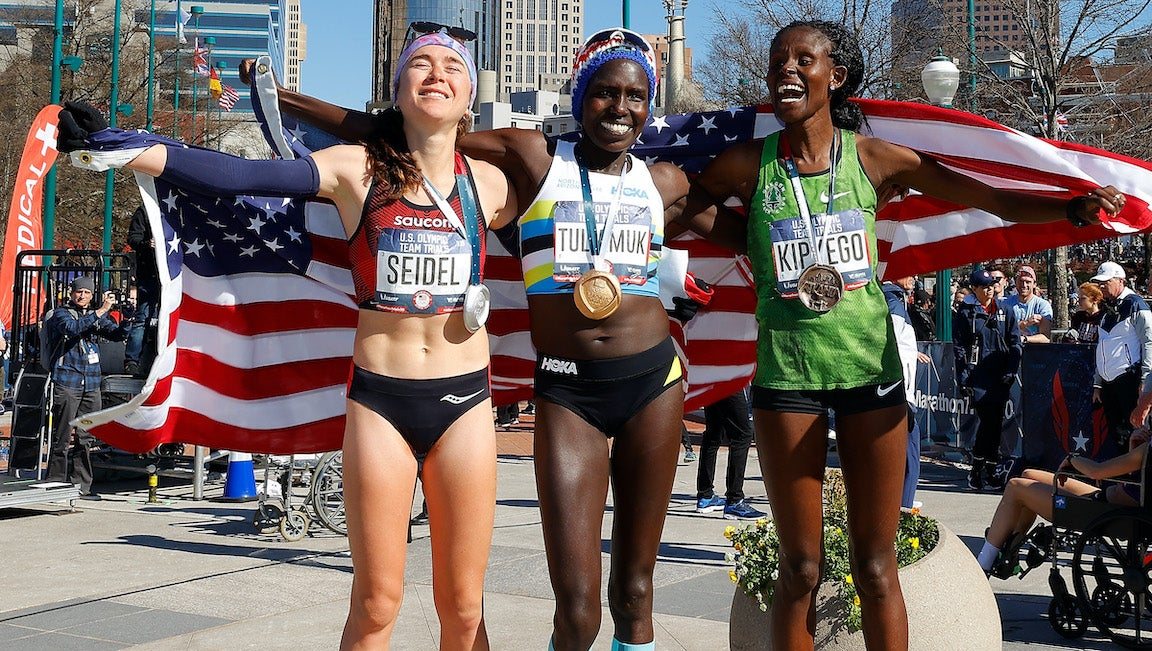 Molly Seidel, Aliphine Tuliamuk, and Sally Kipyego pose after finishing in the top three of the Women's 2020 U.S. Olympic marathon team trials.
