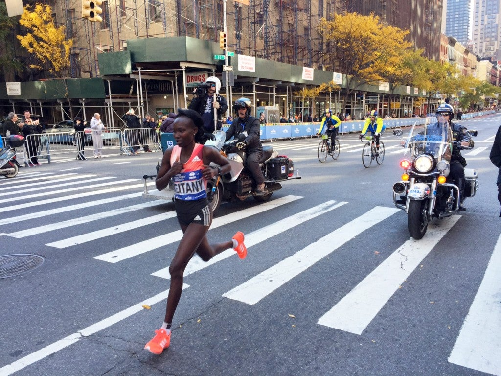 Mary Keitany runs down First Avenue en route to her third straight New York City Marathon title on Sunday.
