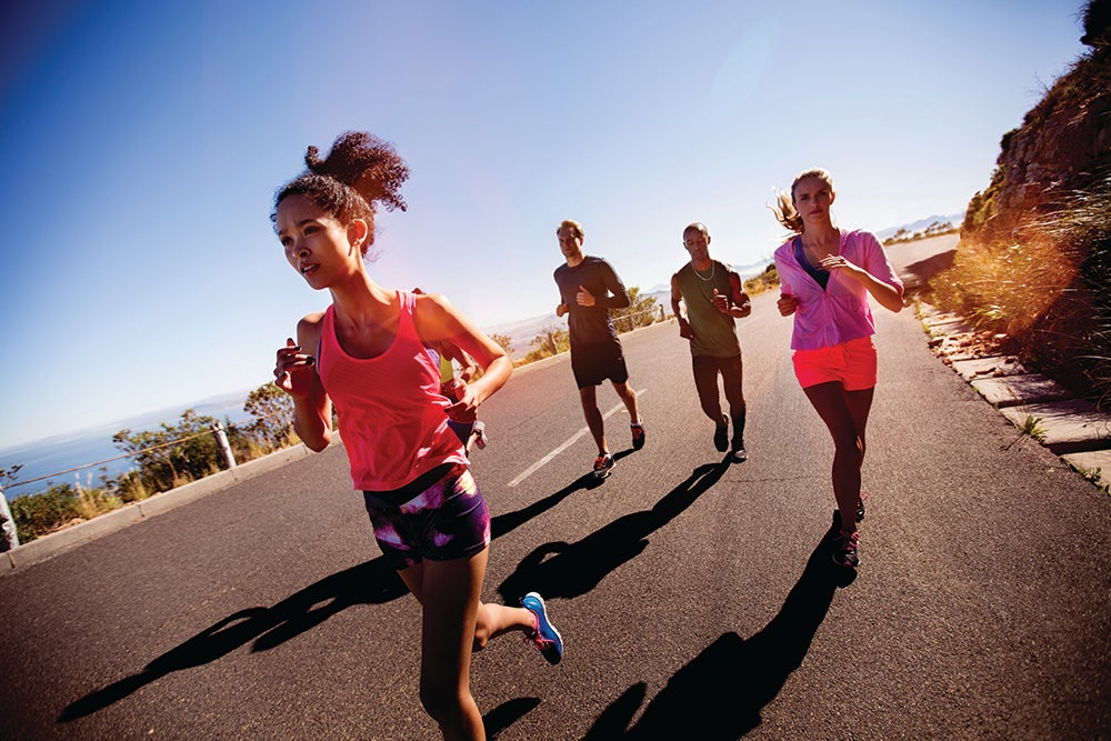 Young adult multi-ethnic group of athletes running outdoors