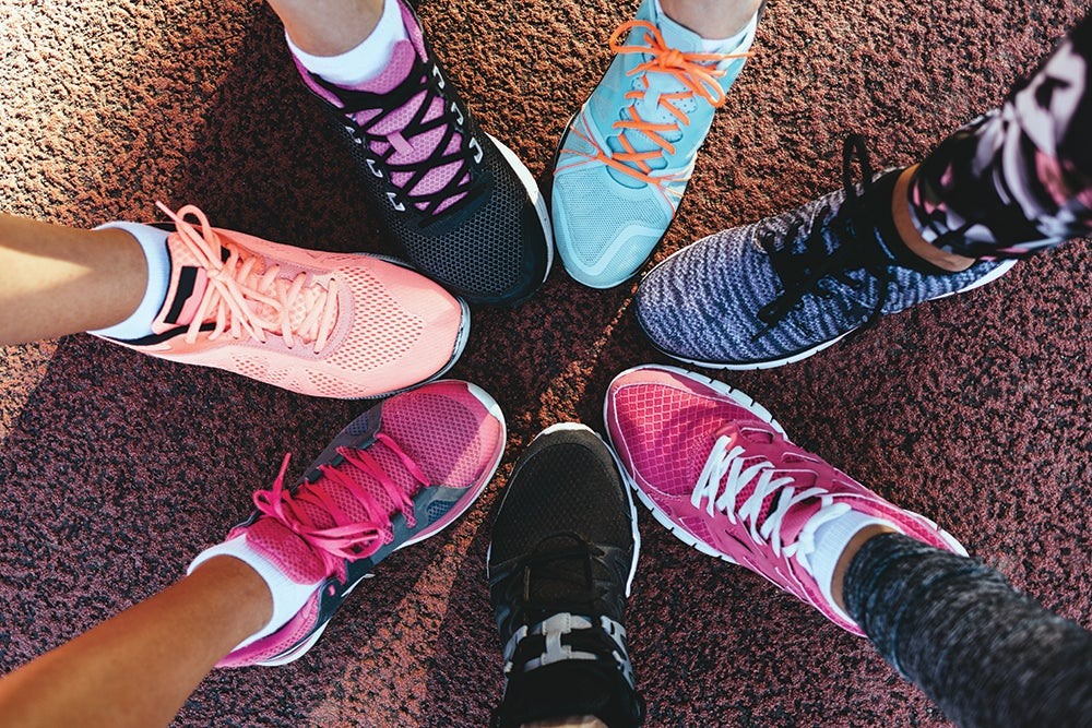 Closeup legs of athletes wearing sports shoes in a circle