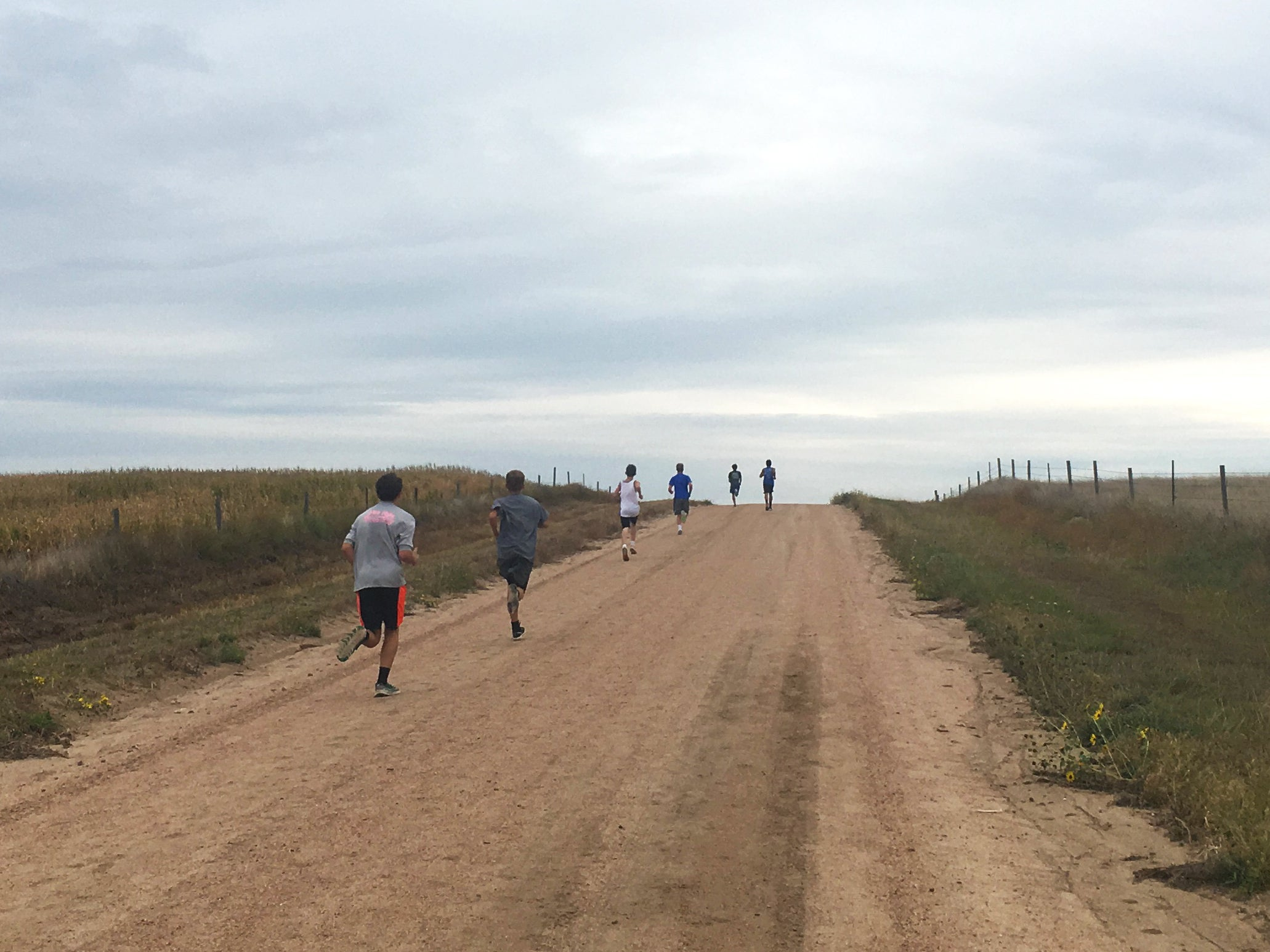 group of runners on long hill