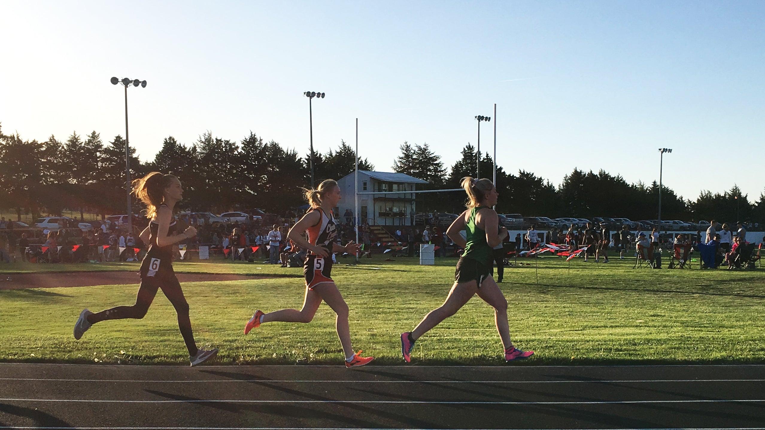 high school track girls distance runners dusk
