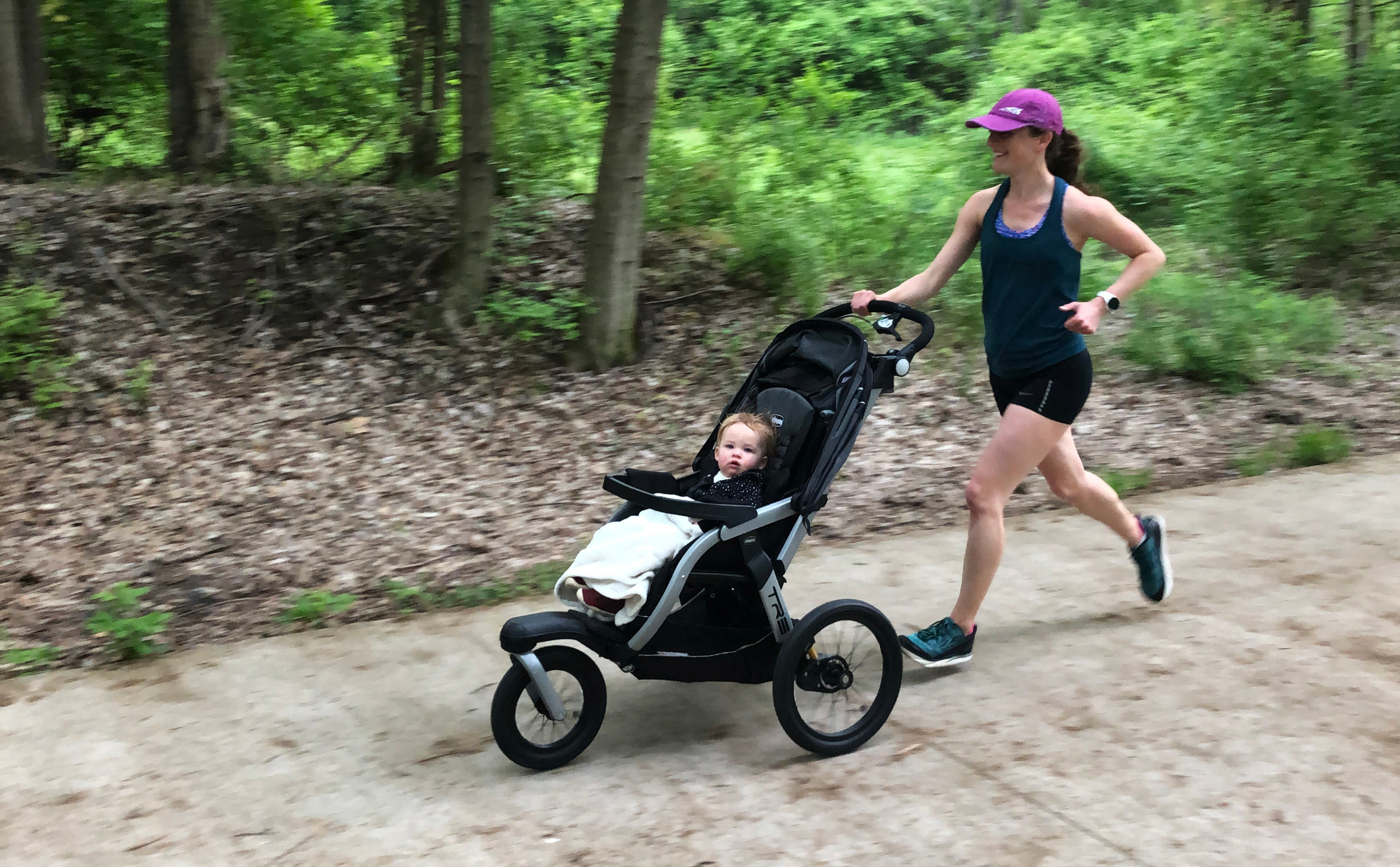 Tina Muir pushing daughter in running stroller