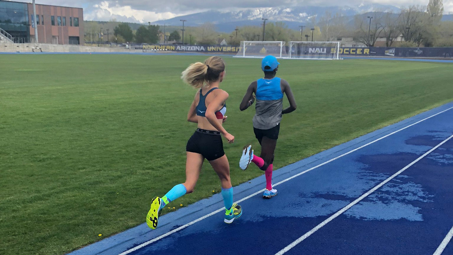 Kellyn Taylor, Aliphine Tuliamuk training on the track in Flagstaff