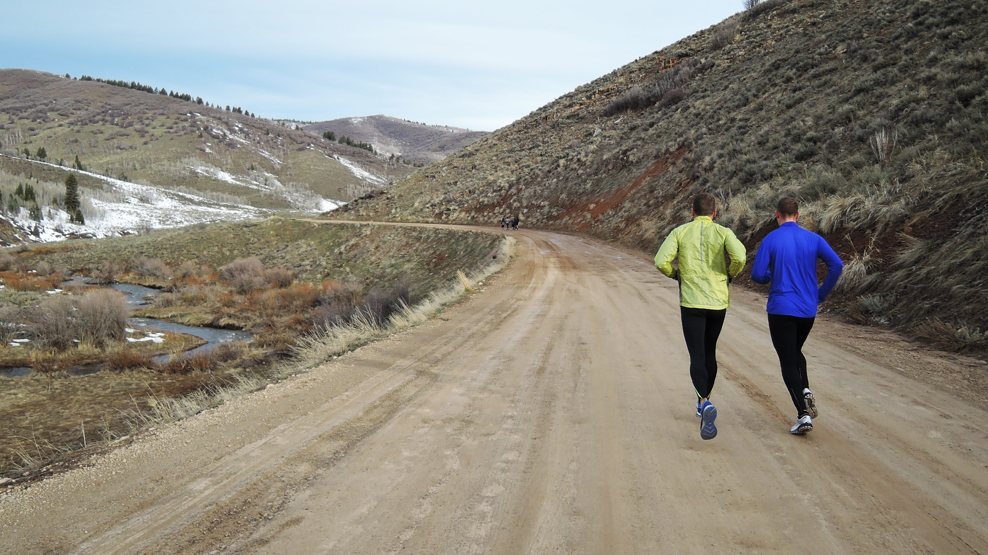 running on dirt road in mountains winter