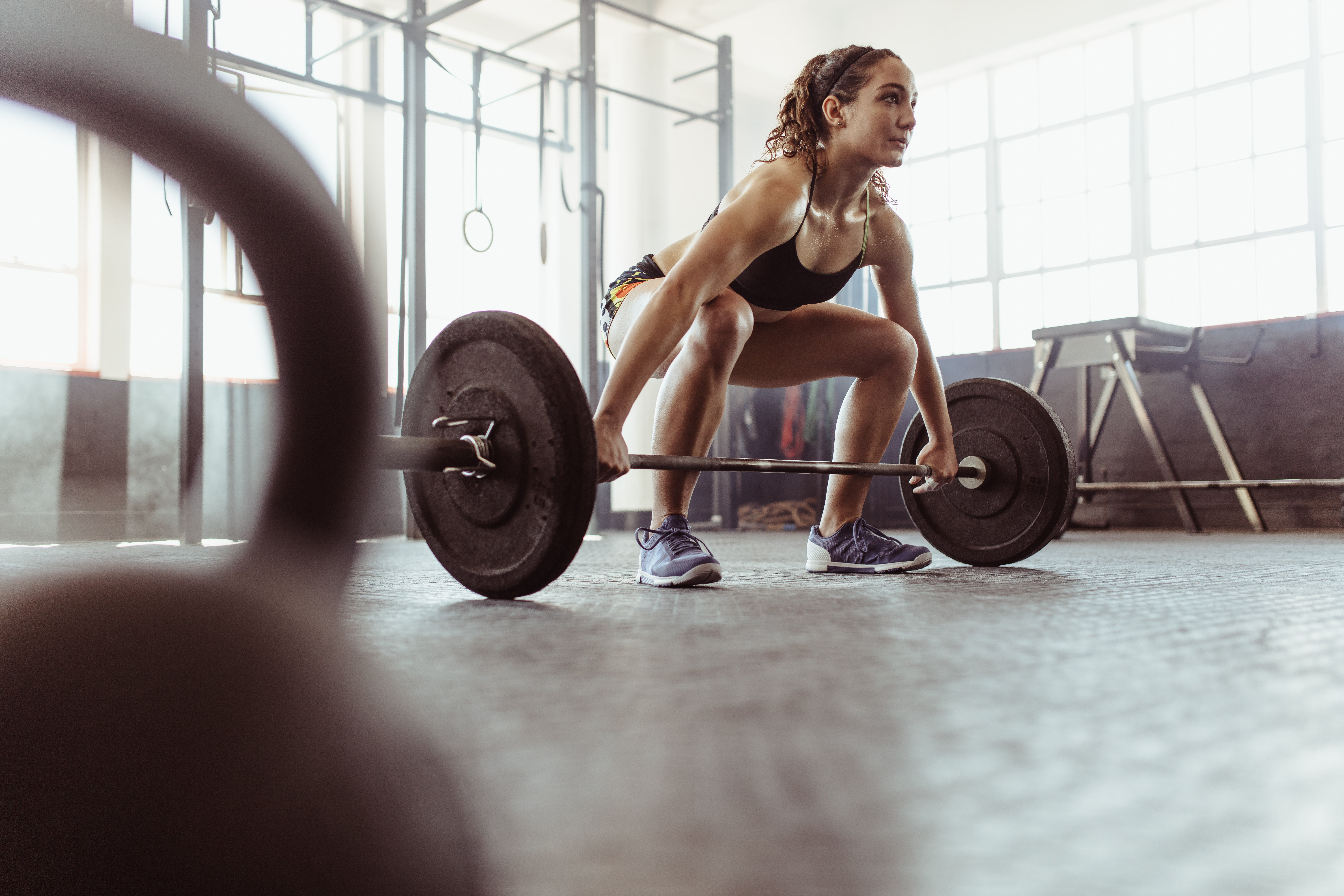 female runner lifting weights