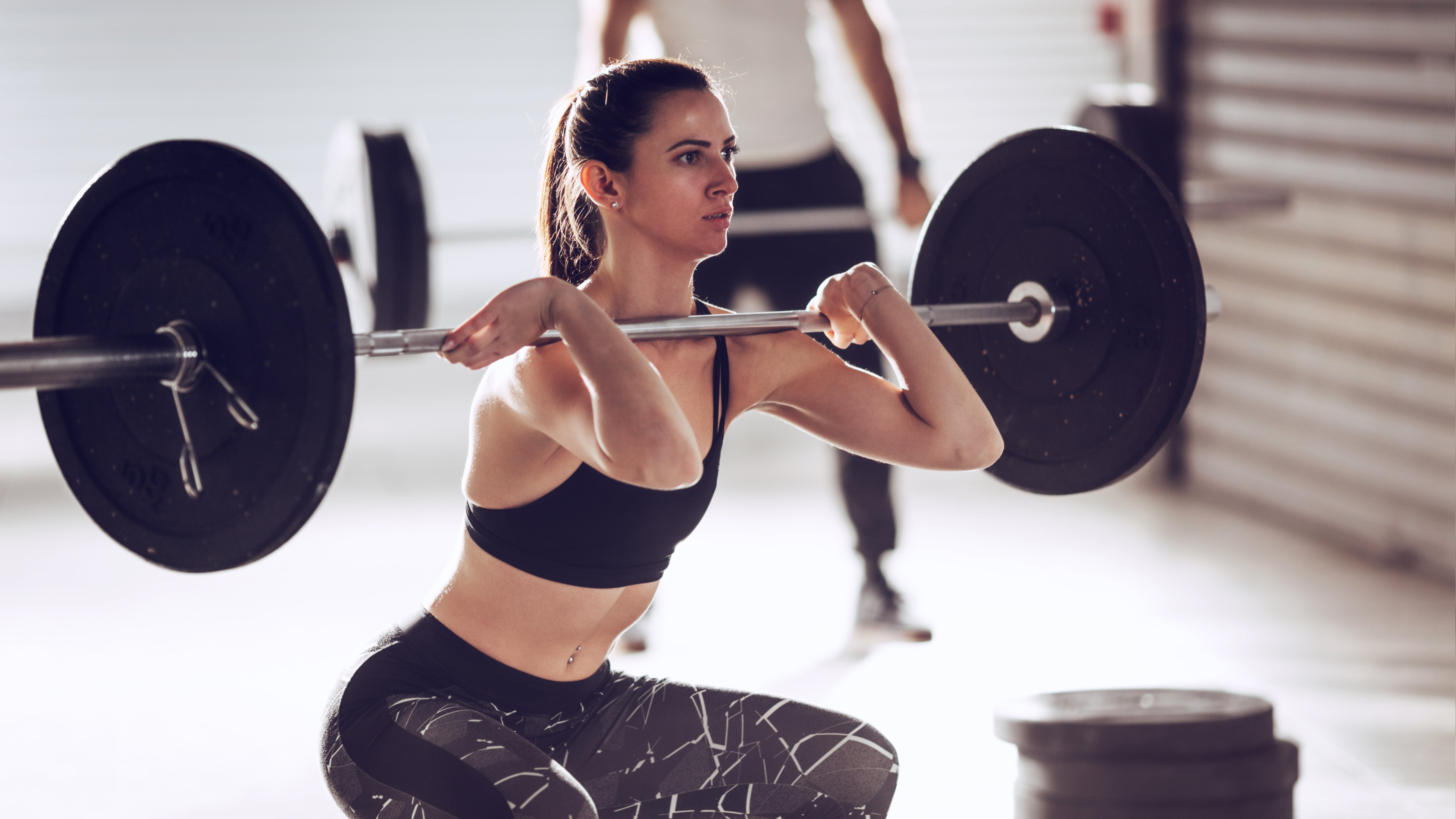 female athlete lifting weights to improve stride