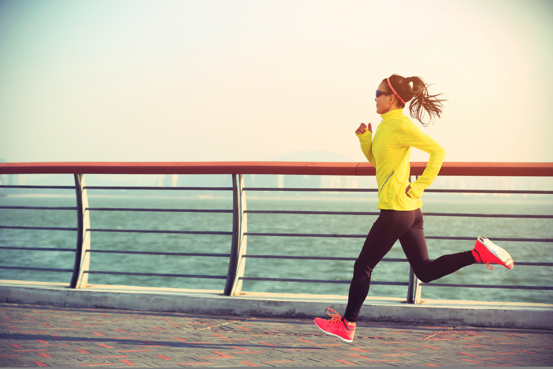 woman runner on bridge speed work