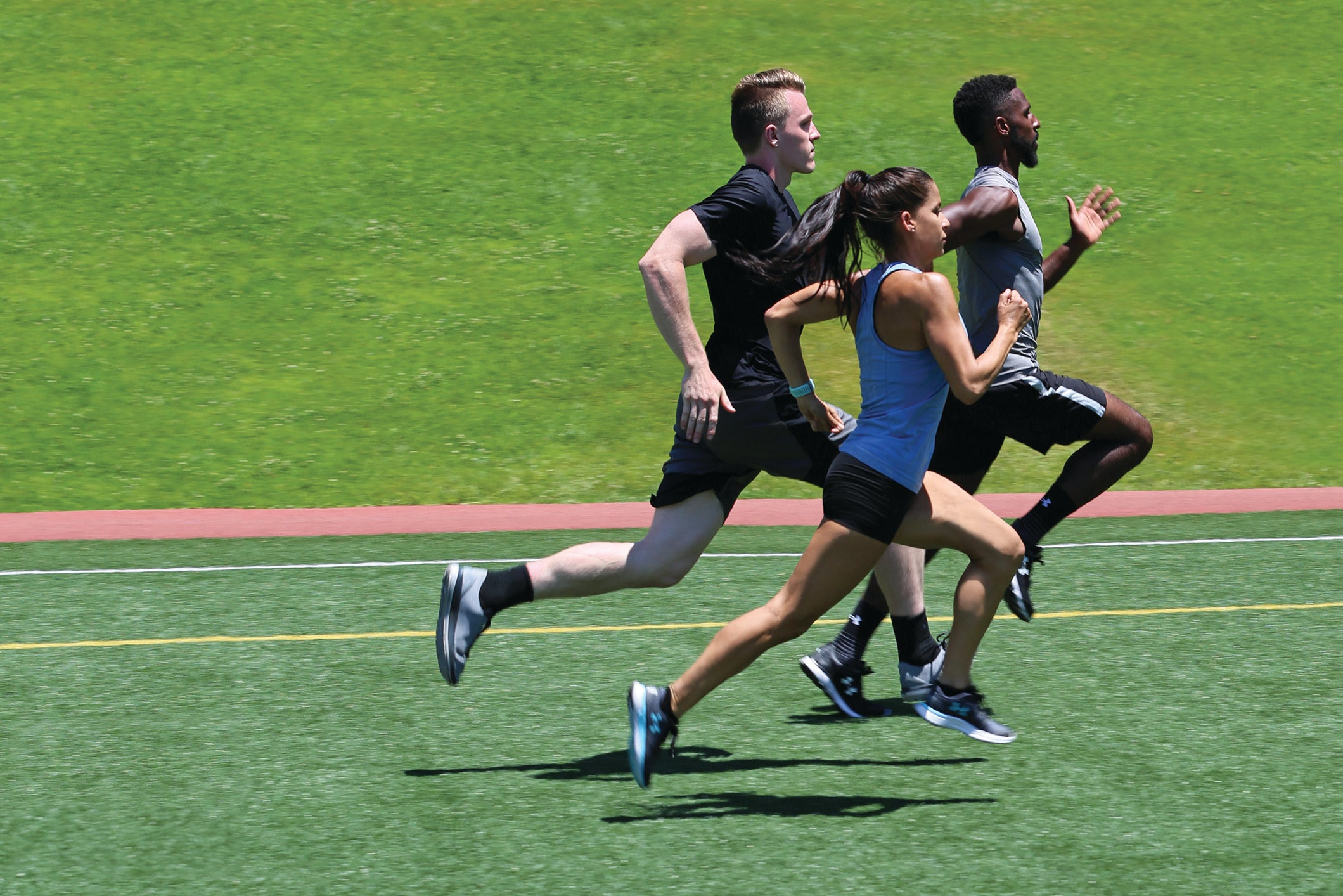 group sprinting on field