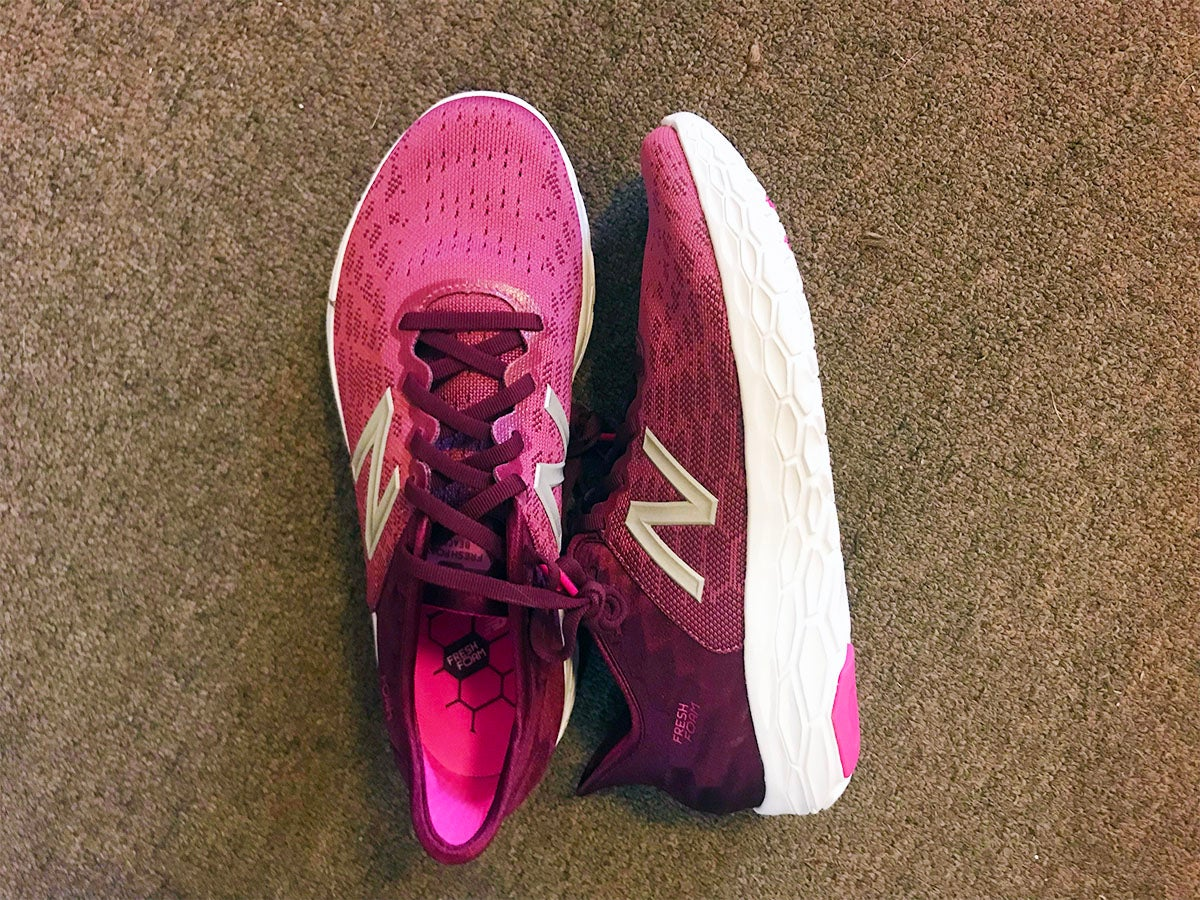 new balance fresh foam v2 running road shoes feature shot. Shot from above with one shoe on its side to show profile