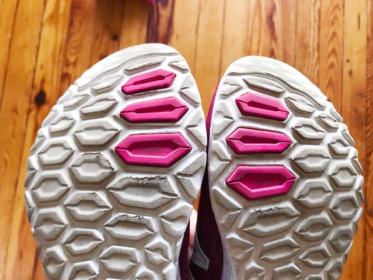 Bottom of new balance fresh foam v2 running shoes showing wear and tear after 100 miles