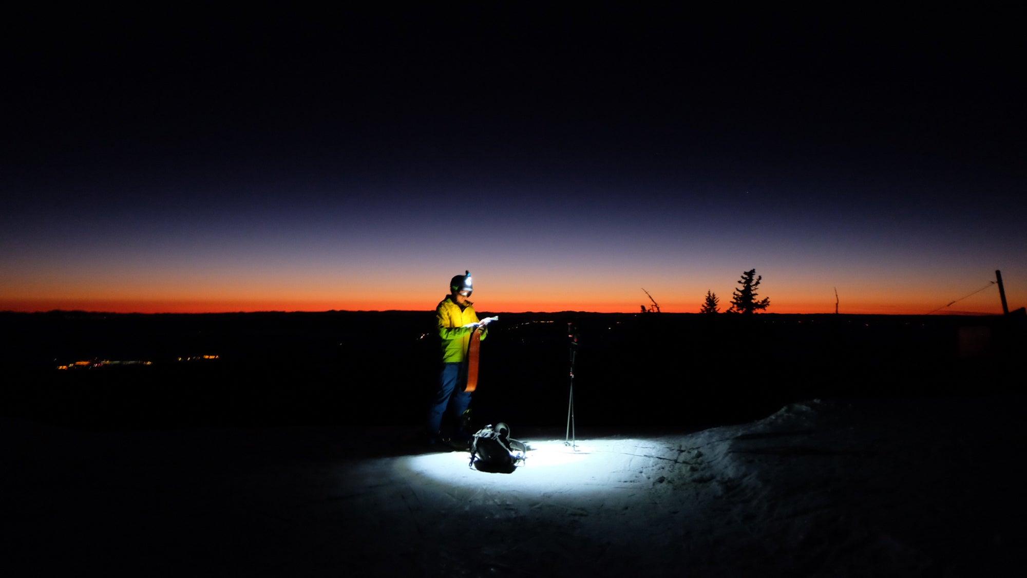 Checking ski routes pre-dawn
