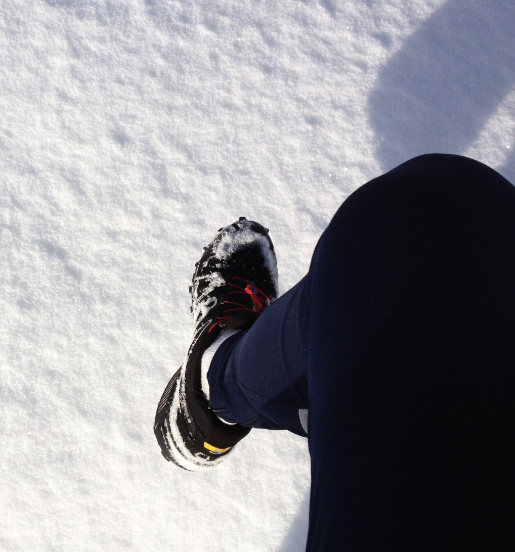 snow covered running shoe