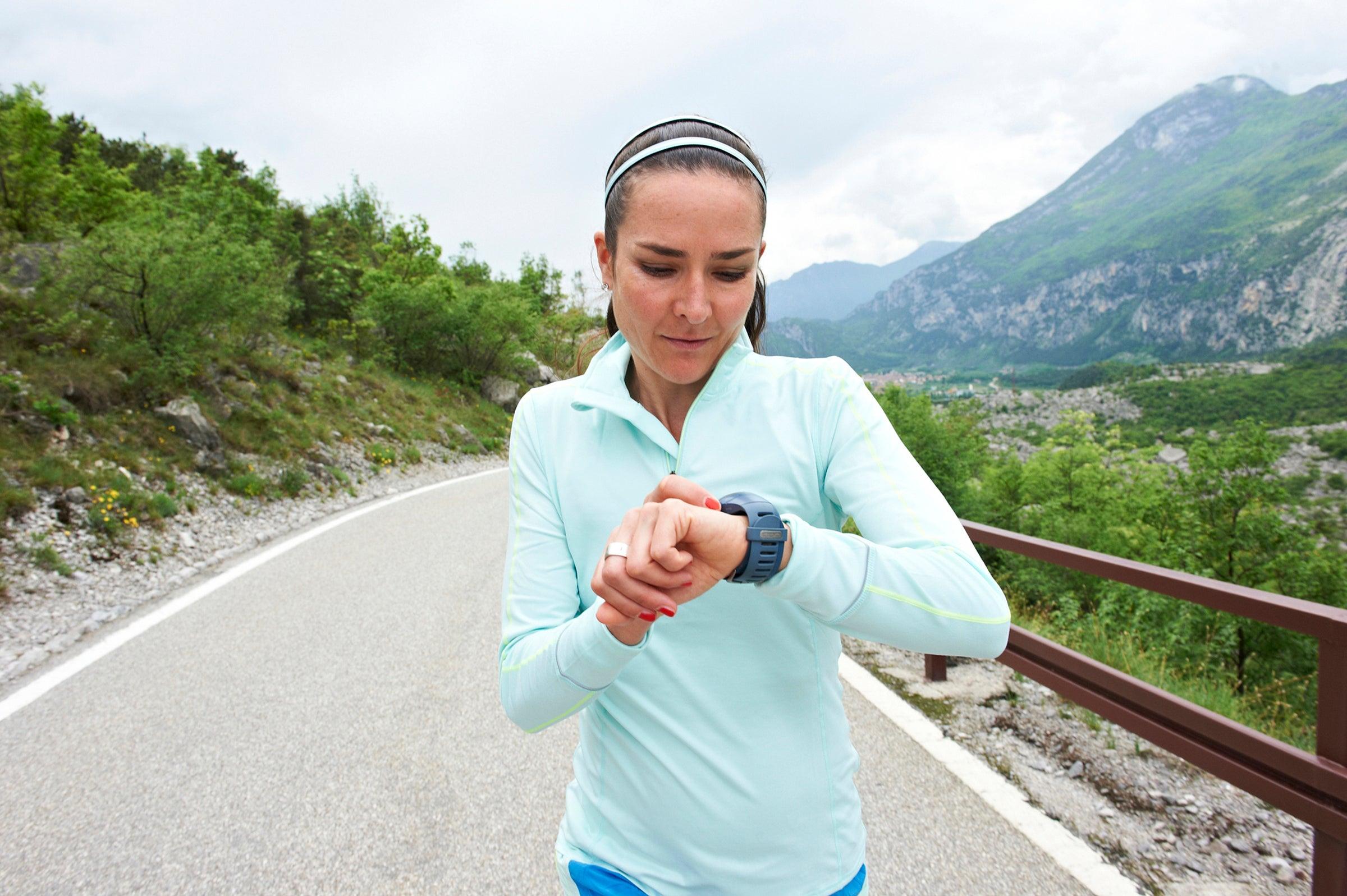 Runner checking heart rate