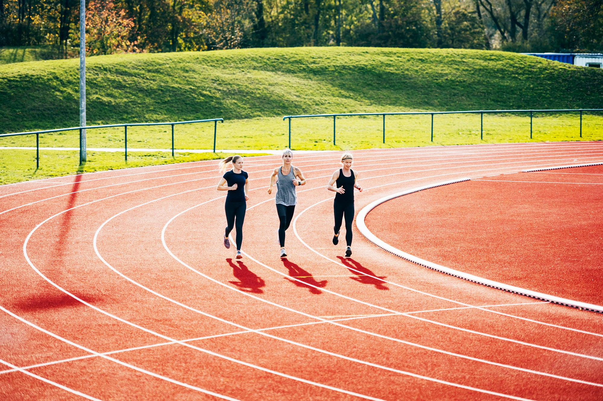 three women doing track workout