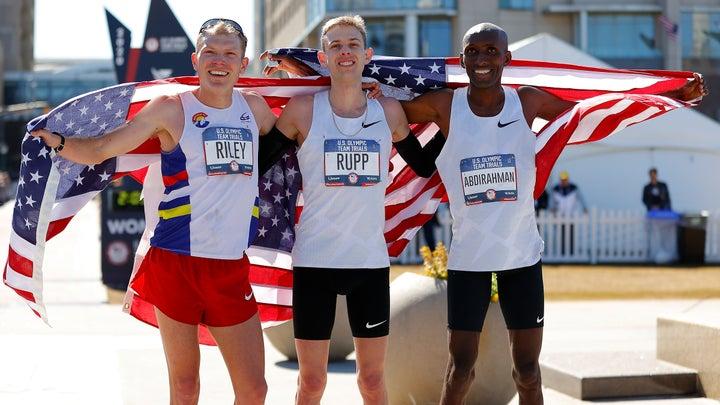 Jacob Riley, Galen Rupp, and Abdi Abdirahman pose together after the Men's U.S. Olympic marathon team trials.