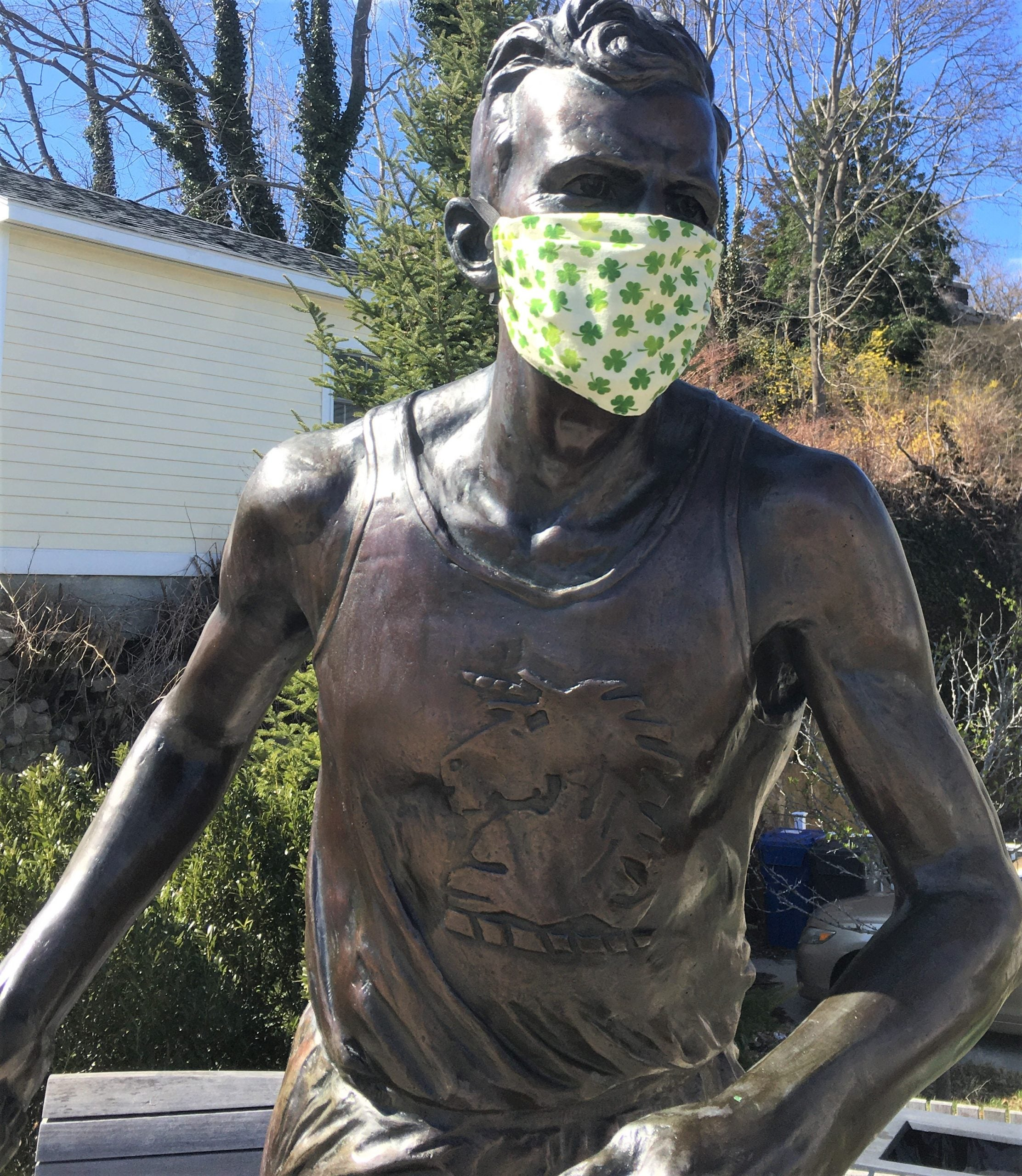mystic Kelley statue with face mask