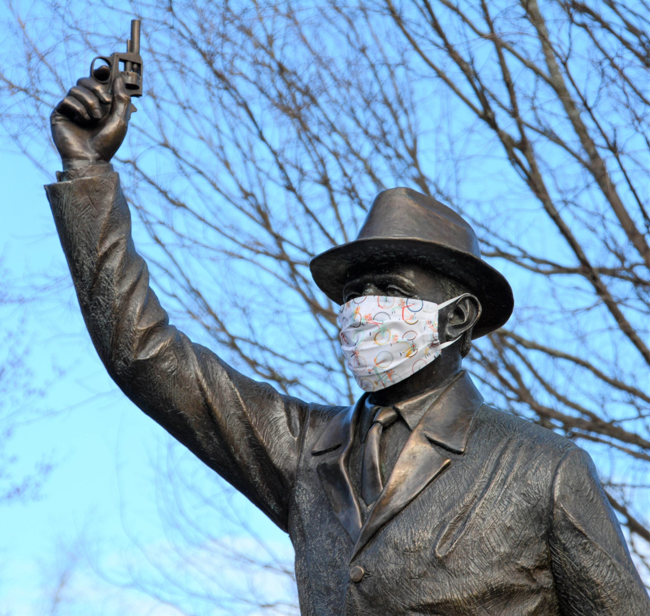 """The Starter"" statue in Hopkinton with face mask"
