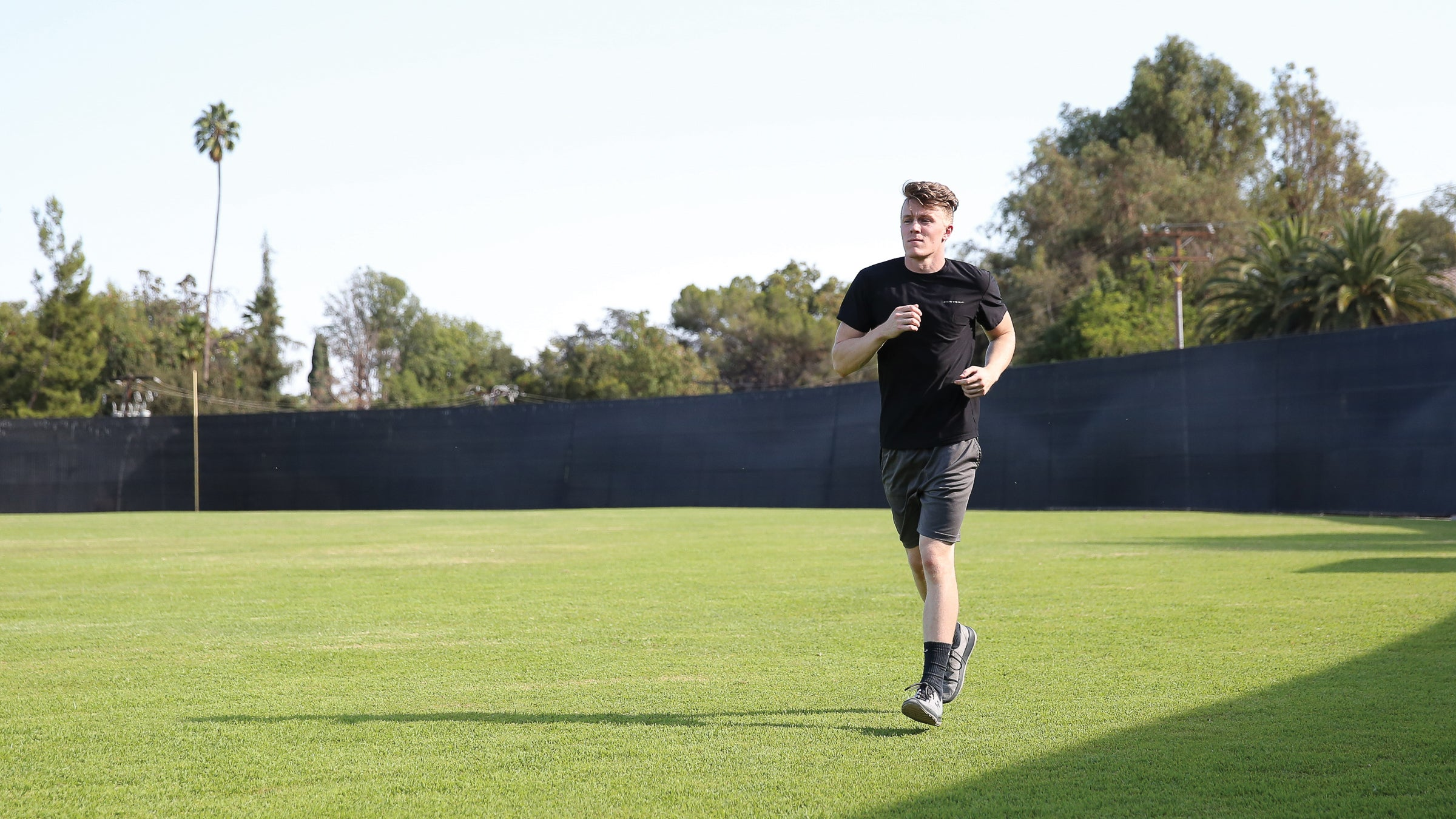 Man jogging on grassy turf