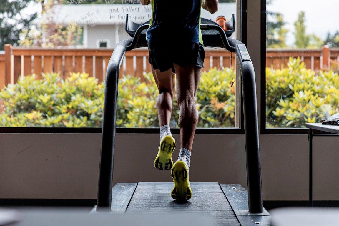 Man's legs running on treadmill.