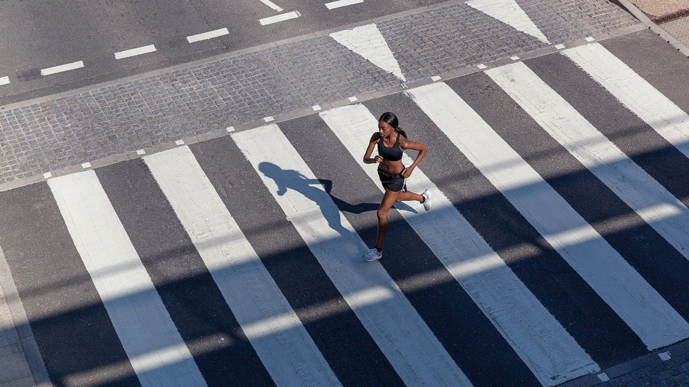 Young woman running on crossing
