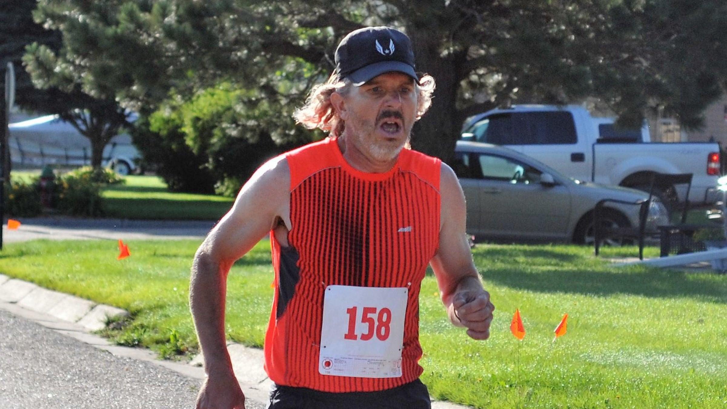 man straining in race