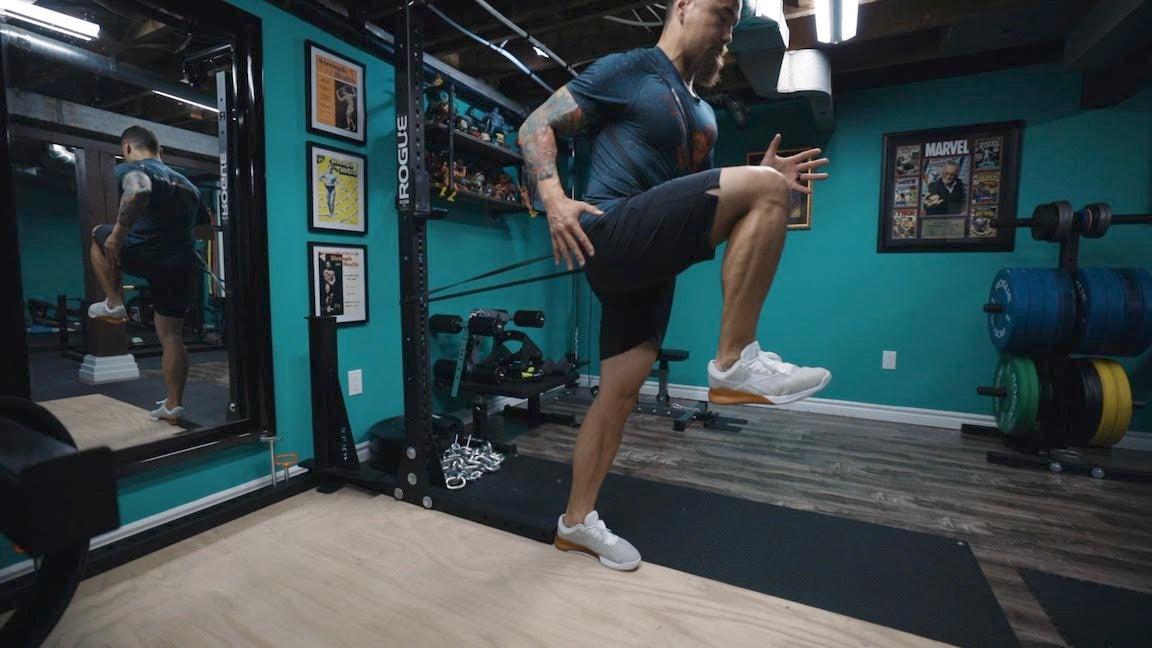Man training in gym.
