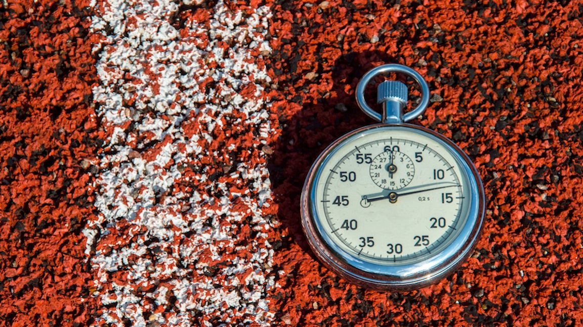 Old sport stopwatch on running track rubber.