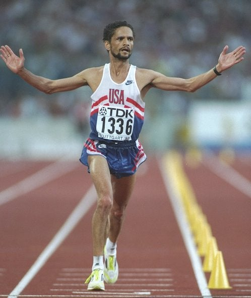 Mark Plaatjes on track raising arms as world champion in 1993 marathon.
