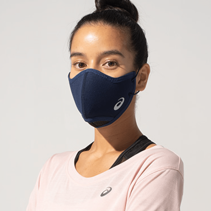 Woman wearing an Asics face covering