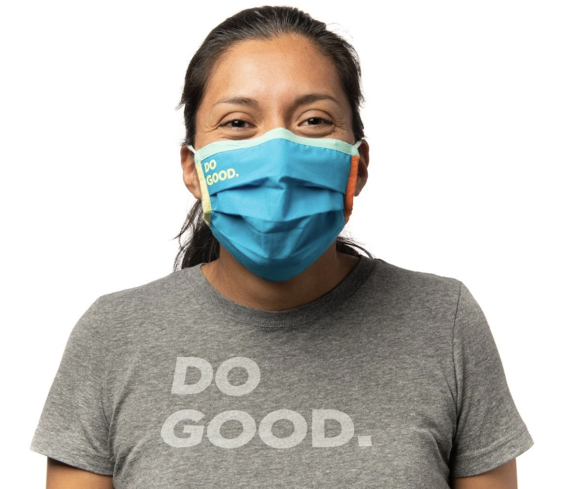 Woman wearing blue Cotopaxi facemask