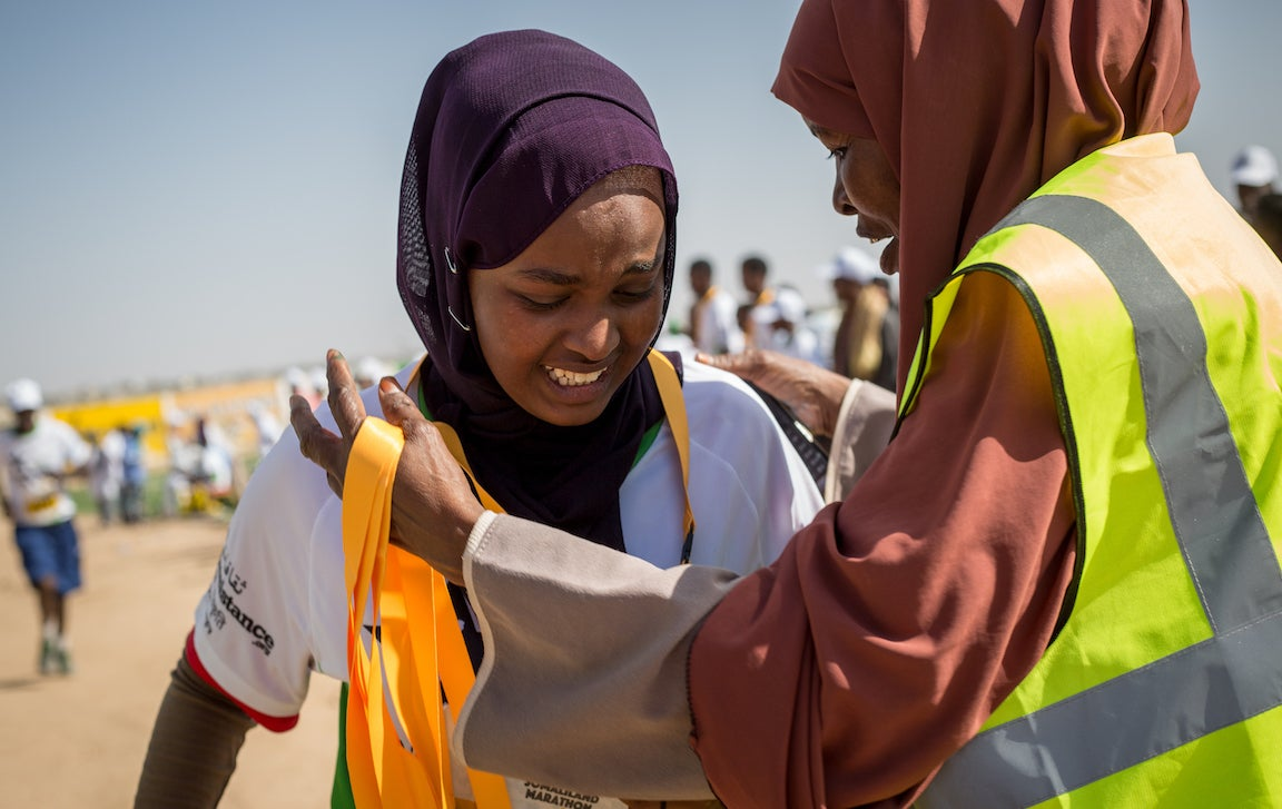 Somali woman getting a medal after competing in the 10K event at the Somaliland Marathon.