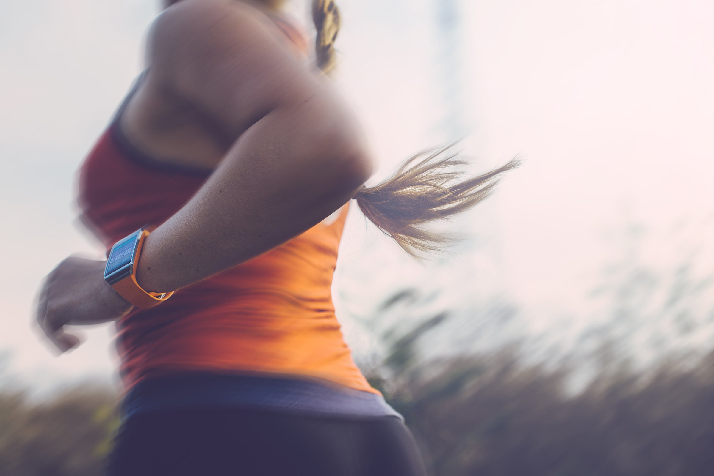 woman running without looking at watch