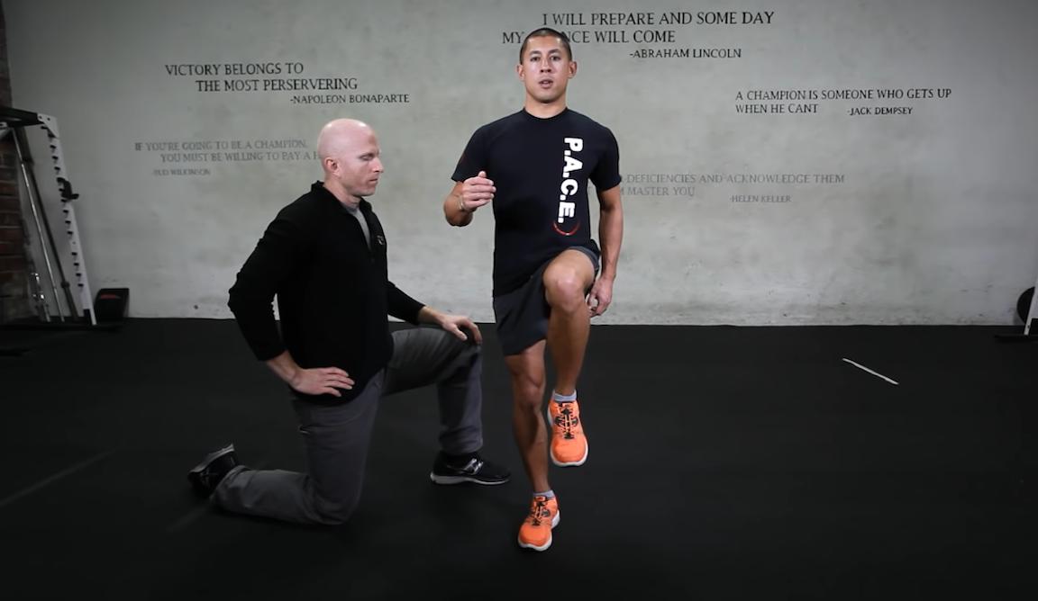 """Man doing the """"runner's touch"""" strength training exercise."""