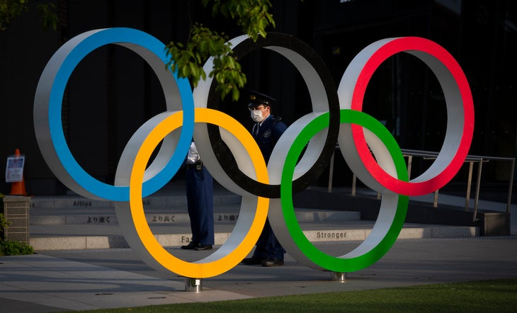 A security worker stands next to the Olympic Rings during a protest against the Tokyo Olympics on May 09, 2021 in Tokyo, Japan. With less than 3 months remaining until the Tokyo 2020 Olympics concern continues to linger in Japan over the feasibility of hosting such a huge event during the ongoing COVID-19 pandemic.