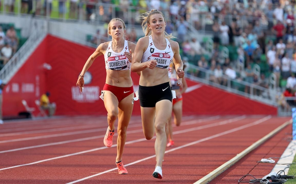 Elise Cranny and Karissa Schweizer compete in the Women's 5000 Meter Final looking strained.