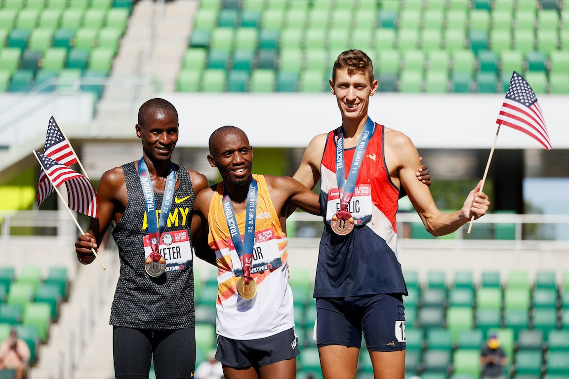 Steeple chase male qualifiers standing with medals and flags on podium at the 2020 Trials.
