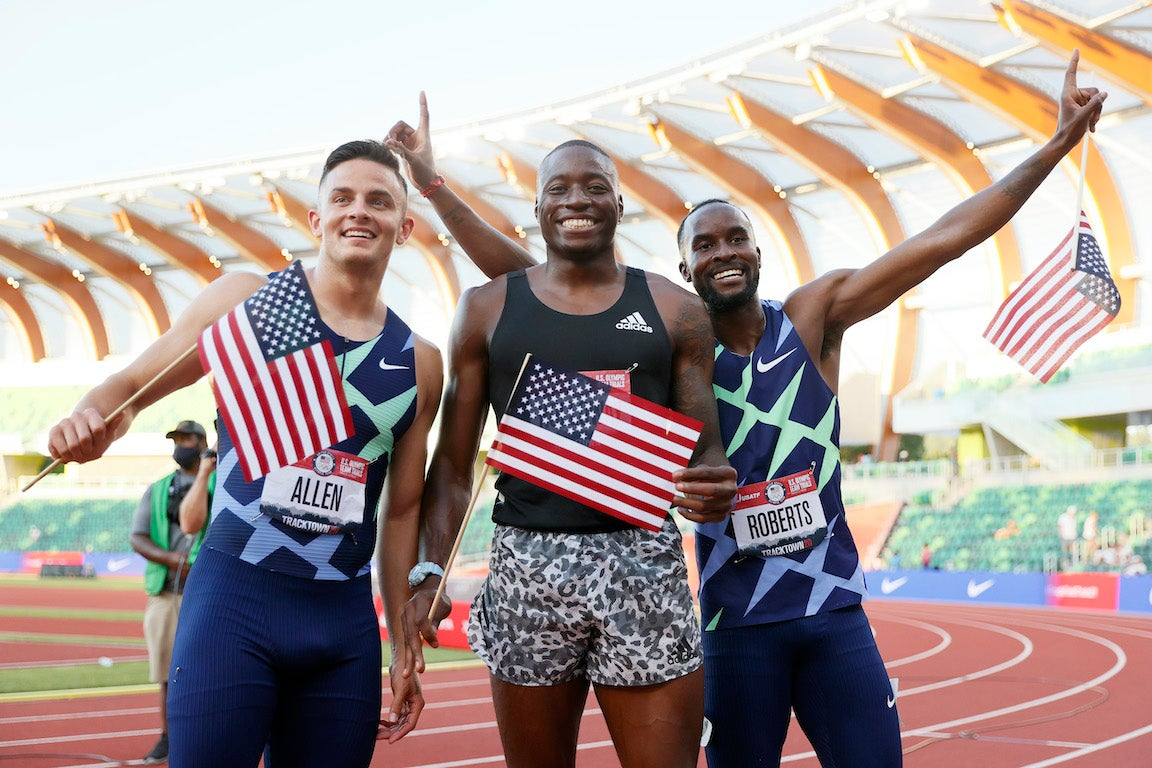 Top three finishers in the Men's 110 Meters Hurdle Final celebrate.